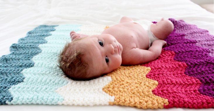 Младенец, вязаное одеяло